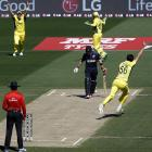 Australia's Mitchell Starc (right) celebrates after bowling New Zealand captain Brendon McCullum...