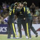 Australia's Peter Forrest (C) celebrates with teammates Ricky Ponting and Brett Lee (R) after...