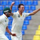 Australia's Trent Copeland (R) celebrates taking the wicket of Sri Lanka's Mahela Jayawardene...