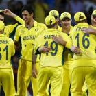 Australian players celebrate their win over India in Sydney. REUTERS/David Gray
