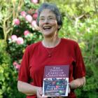 Author Helen Leach with her Christmas cake book. Photo by Peter McIntosh.