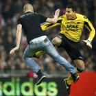 AZ Alkmaar goalkeeper Esteban from Costa Rica reacts as he is attacked on the pitch by an Ajax...