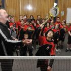 Badminton Otago development officer Jeff Elliotte helps Dunedin North Intermediate year 7 pupil...