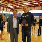 Badminton World Federation development manager Ian Wright stands with president Dr Kaang Young...