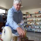 Balclutha Food bank volunteer Ella Kell packs a food parcel for someone in need. Photo by Rachel...