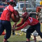 Balclutha team members Jason Watt (left) and Craig Botting compete in the Otago-Southland fire...