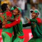Bangladesh bowler Rubel Hossain (L) is congratulated by teammates after bowling England's Stuart...