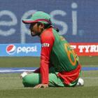 Bangladesh's Anamul Haque sits on the field after dropping a catch off Sri Lankan batsman Lahiru...