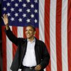 Barack Obama waves as he enters a rally at the University of Cincinnati in Cincinnati, Ohio....