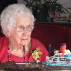 Barbara Lewis inspects her Earnslaw cake at her 100th birthday celebration in Cromwell yesterday....