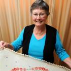 Barbara Rowe with  vintage linen she is selling to raise funds for a foodbank. Photo by Gregor...