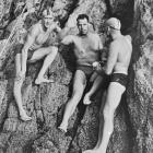 Barrie Devenport (waving), the first person to swim Cook Strait, with final pacers Ian Greenwood ...