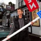 Barry Monahan with one of the new Dunedin City Council parking signs he removed from in front of...