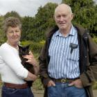 Basil the Burmese cat, having perhaps lost one or two of his nine lives - and pictured with...