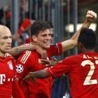 Bayern Munich's Mario Gomez (C) celebrates his goal against Real Madrid with teammates during...