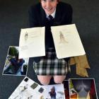 Bayfield High School pupil Emma Rogers-Bromley (16) shows photographs and sketches of her  ...