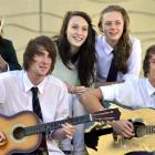 Bayfield High School rock band members (from left) Win Piyaoui, Blake Lewis, Sam Shannon, Grace...