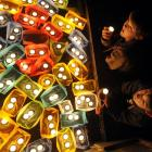 Ben Pinfold, top, and Jesse Milligan (both 12) admire candles lit in Dunedin's Octagon as a part...