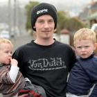 Benjamin Bryant  holds his boys, Jake  and Cooper Wells, who were taken for an unexpected drive...