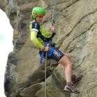 Bex Law, of Rotorua, abseils down a rock face at Bendigo during the Central Otago 24-hour...