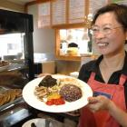 Bi-Hua Huang Lin has graduated with a master of education degree and opened a cafe in Albany St,...