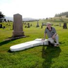 Bill Price surveys the damage to his late mother's headstone at West Taieri Cemetery. Photos by...