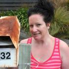 Bindi Leech at her Kaikorai Valley Rd letterbox yesterday. Photo by Gregor Richardson.