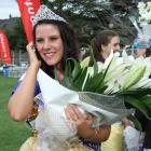 Blossom Festival Queen Ellie Trask (18) takes a congratulatory call after the crowning ceremony....