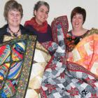 Blue Willow Quilters group members Wendy Culbertson (left) and Yvonne Reid (centre) and Resthaven...