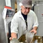 Bluewater Products owner Ross Hutchison weighs New Zealand sole caught at Taieri Mouth. Photo by...