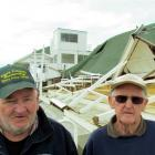 Bob Goodeve (left) and retired trainer Dick Langford stand in front of the remains of the public...
