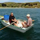 Bob Mitchell (left) and Des Gray, both of Otakou, paddle on after setting a net for moki off...