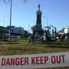 Contractors put a fence around Oamaru's Boer War memorial in preparation for dismantling and...