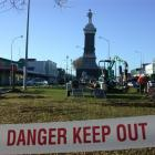 Contractors put up a fence around the Boer War monument in Oamaru in preparation to dismantle and...