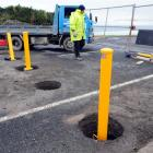 Bollards being installed on John Wilson Ocean Dr last year. Photo by Craig Baxter.