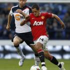 Bolton Wanderers' Gary Cahill chases Manchester United's Javier Hernandez.   REUTERS/Darren Staples