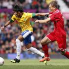 Brazil's Neymar fights for the ball with Belarus' Denis Polyakov.   REUTERS/Andrea Comas