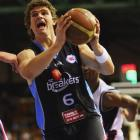 Breakers shooting guard Kirk Penney (above left) drives to the basket during the round seven NBL...
