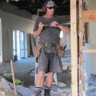 Brian Alexander of Mudgway Construction strips out the interior of the former PGG Wrightson...