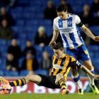 Brighton Hove Albion's Keith Andrews (R) challenges Hull City's Robert Koren. REUTERS/Kieran Doherty