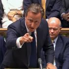 Britain's Prime Minister David Cameron is seen addressing the House of Commons about launching...