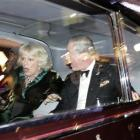 Britain's Prince Charles and Camilla, Duchess of Cornwall, react as their car is attacked by...