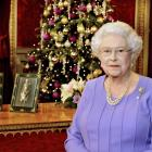 Britain's Queen Elizabeth poses for a photograph as she stands in the State Dining Room of...