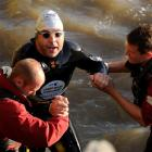 British comedian David Walliams is helped out of the River Thames after his charity swim.  ...