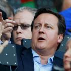 British Prime Minister David Cameron watches Olympics athletics events at the Olympic Stadium in...