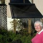 Broad Bay resident Olive Bain admires the solar panel installed in her front yard. Photo by...