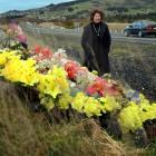 Bronwyn Anderson, of Mosgiel, stands next to the colourful motorway memorial to her daughter,...