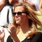Brooklyn Decker, wife of Andy Roddick, watches Roddick's singles match against compatriot Rhyne...
