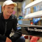 Bryce Abernethy with the boat named after him at the Otago Rowing Club yesterday. Photo by Gregor...