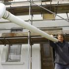 Builder Don Milne returns the 4m kauri flagpole to the White House, in Vauxhall, shortly before...